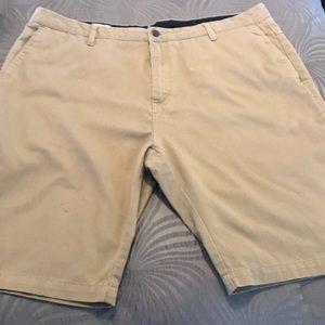 Tan volcom shorts- small light mark on left leg